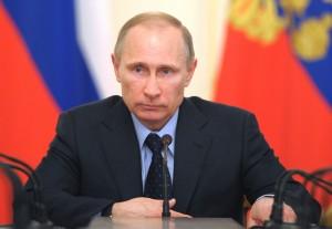 Russian President Vladimir Putin heads the Cabinet meeting at the Novo-Ogaryovo presidential residence outside Moscow on Wednesday, March 5, 2014. (AP Photo/RIA Novosti, Alexei Druzhinin, Presidential Press Service)